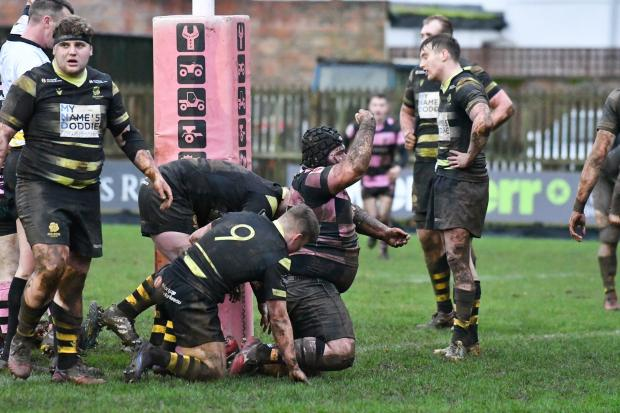 Ben Cree celebrates a try for Ayr: Pic: George McMillan.