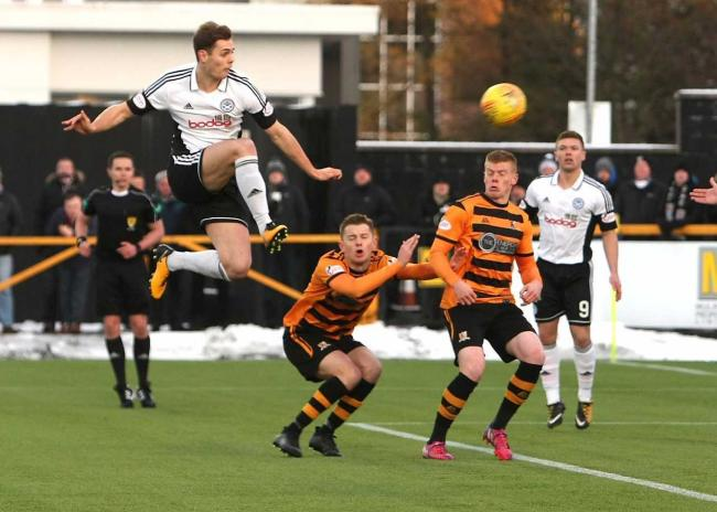 HIGH FLYER: Michael Rose, pictured in action against Alloa last season, is seen as a key player by boss Ian McCall.