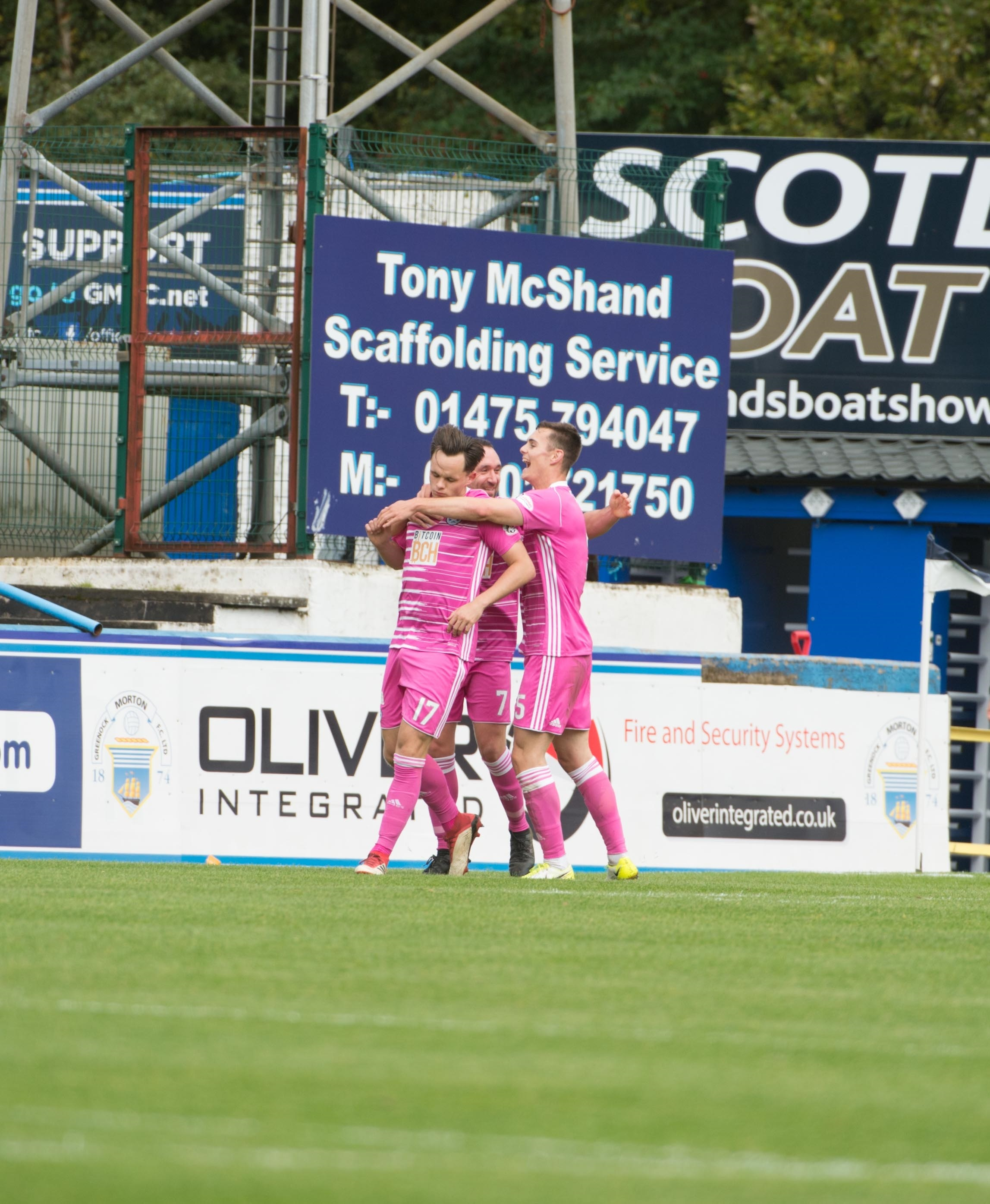CELEBRATION TIME: Stiker Lawrence Shankland is mobbed by team-mafter after blasting Ayr United into the lead at Cappielow on Saturday.
