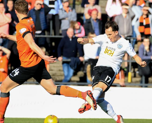 WINNING FORM: Lawrence Shankland opens the scoring for Ayr in their 2-0 win against Dundee United.