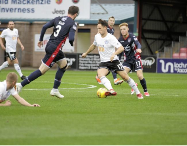 NARROW LOSS: Goalscorer Lawrence Shankland is pictured in action for Ayr United against Ross County.