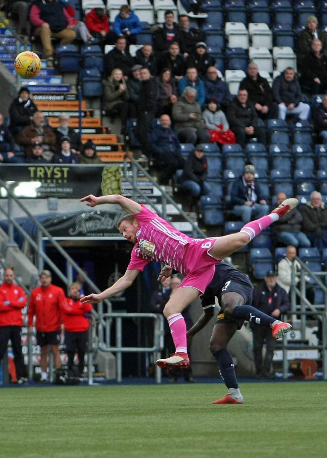 ACROBATIC SKILL: United midfielder Andy Geggan shows off his ball skills at Falkirk Stadium.
