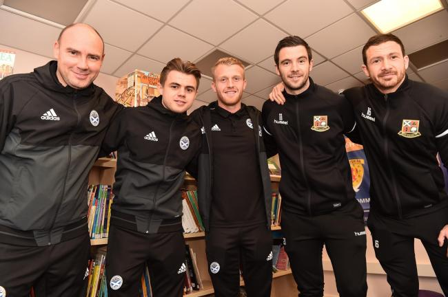 CUP FEVER: Pictured (from left) at Beith Primary School are Ayr United physio Steve Maguire, players Alan Forrest and Robbie Crawford and Steven Noble and Jamie Wilson of Beith Juniors.