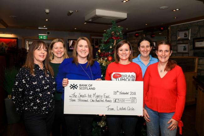GREAT EFFORT: Troon Ladies Circle chairwoman Denise Cook presents a £3100 cheque to Amy McLaughlan (The Small but Mighty Fund) at the Old Loans Inn. Looking on are Circle members, Annette Simpson, Lucy Mullan, Bernadette Young and Ruth Farrell.